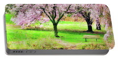 Portable Battery Charger featuring the photograph Empty Bench Surrounded By Spring Colors by Gary Slawsky