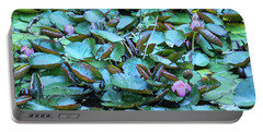 Portable Battery Charger featuring the photograph Painted Water Lilies by Theresa Tahara