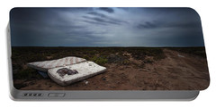Portable Battery Charger featuring the photograph End Of The Earth by Tim Nichols