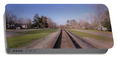 Portable Battery Charger featuring the photograph Endless Railroad by Aaron Martens