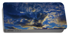 Portable Battery Charger featuring the photograph Erupting Sunset by Mark Blauhoefer