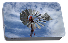 Portable Battery Charger featuring the photograph Facing Into The Breeze by Stephen Mitchell