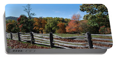 Fall Fence Portable Battery Charger by Eric Liller
