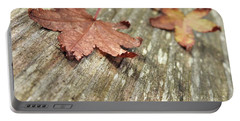 Portable Battery Charger featuring the photograph Fallen Leaves by Peggy Hughes