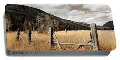 Portable Battery Charger featuring the photograph Fallowfield Weathered Fence Rocky Mountain National Park Dramatic Sky by John Stephens