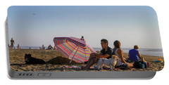 Family At Ocean Beach With Dogs Portable Battery Charger