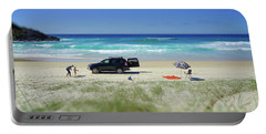 Family Day On Beach With 4wd Car  Portable Battery Charger