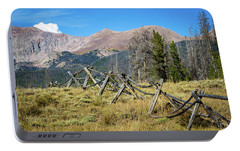Portable Battery Charger featuring the photograph Fences Into The Rockies by Dawn Romine