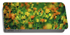 Field Of Orange And Yellow Daisies Portable Battery Charger