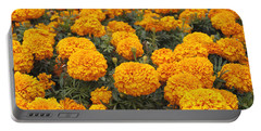 Field Of Orange Marigolds Portable Battery Charger