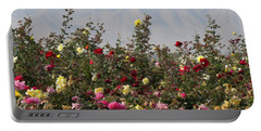 Portable Battery Charger featuring the photograph Field Of Roses by Laurel Powell