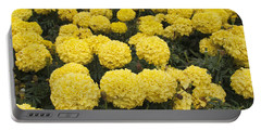 Field Of Yellow Marigolds Portable Battery Charger