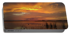 Portable Battery Charger featuring the photograph Fiery Sunset by Liza Eckardt