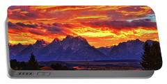 Portable Battery Charger featuring the photograph Fire In The Teton Sky by Greg Norrell