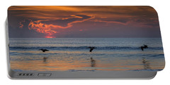 Portable Battery Charger featuring the photograph First Flight First Light by Steven Sparks