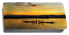 Portable Battery Charger featuring the photograph Fisherman On Their Boat by Pradeep Raja Prints
