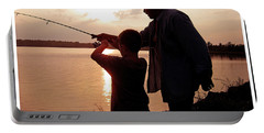 Fishing At Sunset Grandfather And Grandson Portable Battery Charger