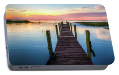 Portable Battery Charger featuring the photograph Fishing Dock At Sunrise by Debra and Dave Vanderlaan