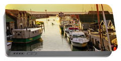 Portable Battery Charger featuring the photograph Fishtown by Alexey Stiop