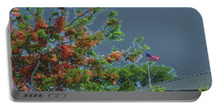 Flag And Shower Tree Portable Battery Charger by Craig Wood