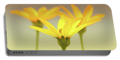 Portable Battery Charger featuring the photograph Floral Brilliance by Anita Oakley