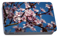 Portable Battery Charger featuring the photograph Flowering Of The Plum Tree 5 by Jean Bernard Roussilhe