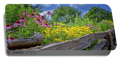 Flowers Along A Wooden Fence Portable Battery Charger