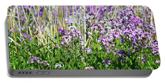 Flowers In The Field  Portable Battery Charger by Lyle Crump