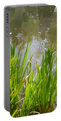 Portable Battery Charger featuring the painting Flowers In The Water by Esther Newman-Cohen