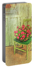 Portable Battery Charger featuring the photograph Flowers On Green Chair by Lewis Mann