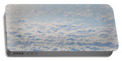 Portable Battery Charger featuring the photograph Flying Among The Clouds by Bill Cannon
