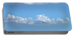 Portable Battery Charger featuring the photograph Flying By The Sea by Francesca Mackenney
