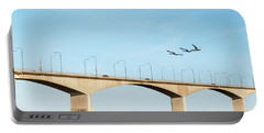 Portable Battery Charger featuring the photograph Flying Swans By The Bridge by Kennerth and Birgitta Kullman