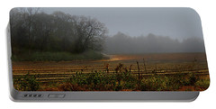 Portable Battery Charger featuring the photograph Fog In The Field by Laura Ragland