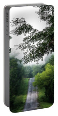 Portable Battery Charger featuring the photograph Foggy Road To Eternity  by Shelby Young
