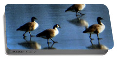 Four Geese Walking On Ice Portable Battery Charger