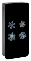 Portable Battery Charger featuring the photograph Four Snowflakes On Black 2 by Alexey Kljatov