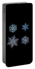 Four Snowflakes On Black Background Portable Battery Charger