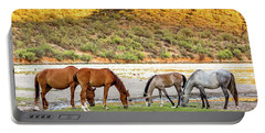 Four Wild Horses Grazing Along Arizona River Portable Battery Charger