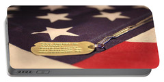 Portable Battery Charger featuring the photograph Freedom's Price by Laddie Halupa