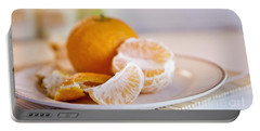 Portable Battery Charger featuring the photograph Freshly Peeled Citrus by Cindy Garber Iverson