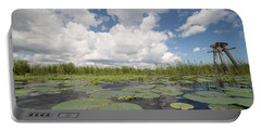 From A Frog's Point Of View - Lake Okeechobee Portable Battery Charger by Christopher L Thomley
