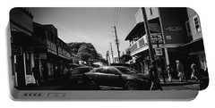 Portable Battery Charger featuring the photograph Front Street  by Sharon Mau