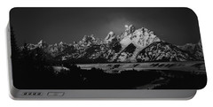 Portable Battery Charger featuring the photograph Full Moon Sets In The Tetons by Raymond Salani III