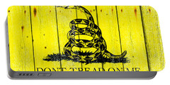 Gadsden Flag On Old Wood Planks Portable Battery Charger