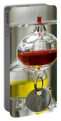 Portable Battery Charger featuring the photograph Galileo Thermometer by Jeremy Lavender Photography