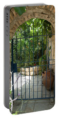 Portable Battery Charger featuring the photograph Garden Door Entrance by Yoel Koskas