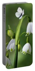 Garden Snowdrops Portable Battery Charger by Nina Bradica
