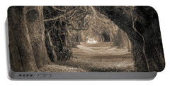 Portable Battery Charger featuring the photograph Gateway Through An Avenue Of Live Oaks by Chris Bordeleau