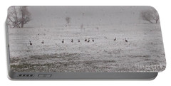 Geese During The Snow Storm Portable Battery Charger